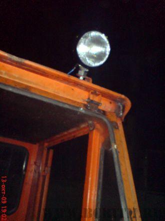 Установка фары кабины экскаватора